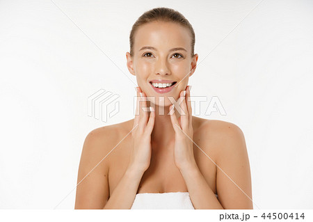Beautiful young woman with clean fresh perfect skin. Portrait of model with natural nude make up 44500414