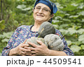 Happy elderly woman farmer portrait  44509541