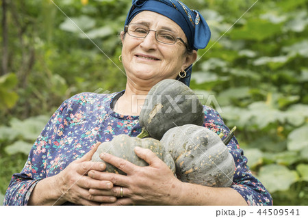 Happy elderly woman farmer portrait  44509541