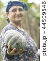 Happy elderly muslim woman farmer holding pumpkin 44509546