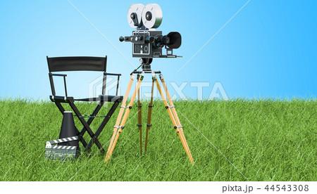 Cinema concept. Movie camera with film reels 44543308