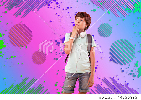 Pensive reflective boy having idea on background 44556835