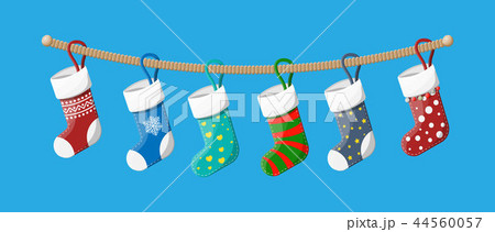 Christmas stockings in various colors on rope 44560057