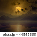 Full moon in night sky with reflection in water 44562665