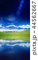 Green hill, high mountain, white clouds 44562667
