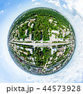Aerial city view with crossroads and roads, houses, buildings, parks and parking lots. Sunny summer 44573928