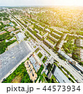 Aerial city view with crossroads and roads, houses, buildings, parks and parking lots. Sunny summer 44573934