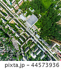 Aerial city view with crossroads and roads, houses, buildings, parks and parking lots. Sunny summer 44573936
