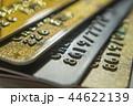Gold and platinum credit cards close up 44622139