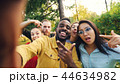 Point of view shot of friends taking selfie in park looking at camera, making funny faces and 44634982
