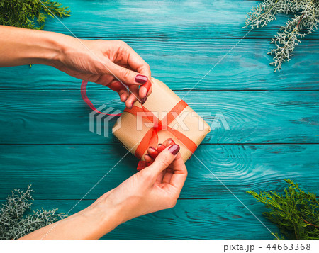 Christmas background with gift box and woman hands 44663368
