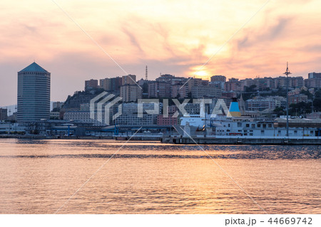 Ships parked in Porto Antico at sunset 44669742