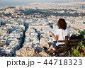 woman with a map sitting on Lycabettus Hill 44718323