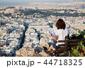woman with a map sitting on Lycabettus Hill 44718325