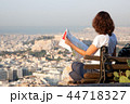 woman with a map sitting on Lycabettus Hill 44718327