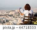 woman with a map sitting on Lycabettus Hill 44718333