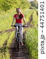 Cute young girl on bicycle 44751401
