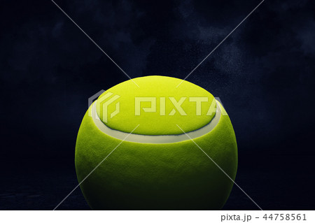 3d rendering of a yellow tennis ball shown in close view on a dark background. 44758561