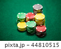 Casino chips on green table 44810515