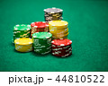 Casino chips on green table 44810522