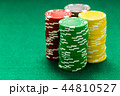 Casino chips on green table 44810527