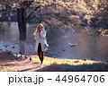 shore pond park adult girl / walk in city park, beautiful girl near pond in urban outdoor recreation area 44964706