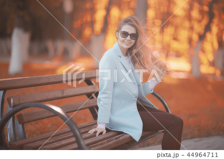 walk in autumn park / beautiful girl in autumn park, model female happiness and fun in yellow trees October 44964711