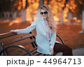walk in autumn park / beautiful girl in autumn park, model female happiness and fun in yellow trees October 44964713