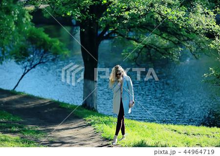 spring, female seasonal portrait / walk happy girl outdoors, spring mood girl 44964719