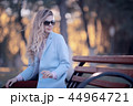 walk in autumn park / beautiful girl in autumn park, model female happiness and fun in yellow trees October 44964721