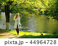 summer girl outdoor air / cheerful adult girl model on a summer walk in the city park, happiness, pleasure freedom 44964728