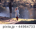 shore pond park adult girl / walk in city park, beautiful girl near pond in urban outdoor recreation area 44964733
