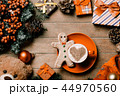 cup of coffee, gingerbread man and christmas decorations 44970560