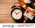 clock and christmas decorations 44970577
