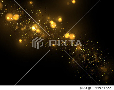 Shiny golden particles on dark 44974722