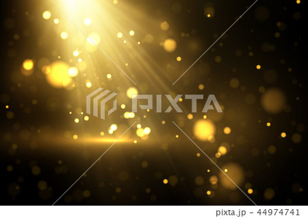 Shiny golden particles on dark 44974741