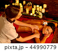 Massage of woman in spa salon. Luxary interior oriental therapy . 44990779