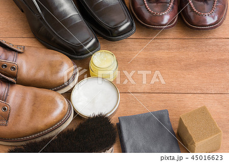 close up of old leather shoes on wooden table 45016623