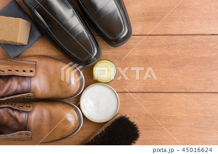 top view of old leather shoes on wooden table 45016624