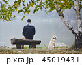 Man with dog in autumn nature 45019431