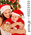Happy Christmas family mother and son open gift box. 45023550