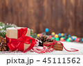 Christmas gift box, candy canes and tree 45111562