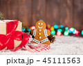 Christmas gift box, candy canes and gingerbread  45111563