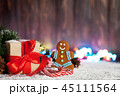 Christmas gift, candy canes and gingerbread man 45111564