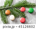 Merry Christmas card. Variety of sweet macaroons and fir branches on a gray vintage background. flat 45126602