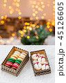 Variety of sweet macaroons in carton box. Cookie in the form of a snowman. Merry Christmas card. New 45126605