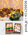 Variety of sweet macaroons in carton box. Cookie in the form of a snowman. Merry Christmas card. New 45126606