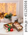 Variety of sweet macaroons in carton box. Cookie in the form of a snowman. Merry Christmas card. New 45126608