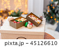 Variety of sweet macaroons in carton box. Cookie in the form of a snowman. Merry Christmas card. New 45126610