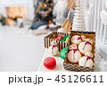 Variety of sweet macaroons in carton box. Cookie in the form of a snowman. Merry Christmas card. New 45126611